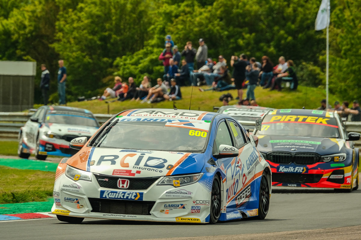 Cobra Sport AmD with AutoAid/RCIB Insurance Racing target strong Croft display